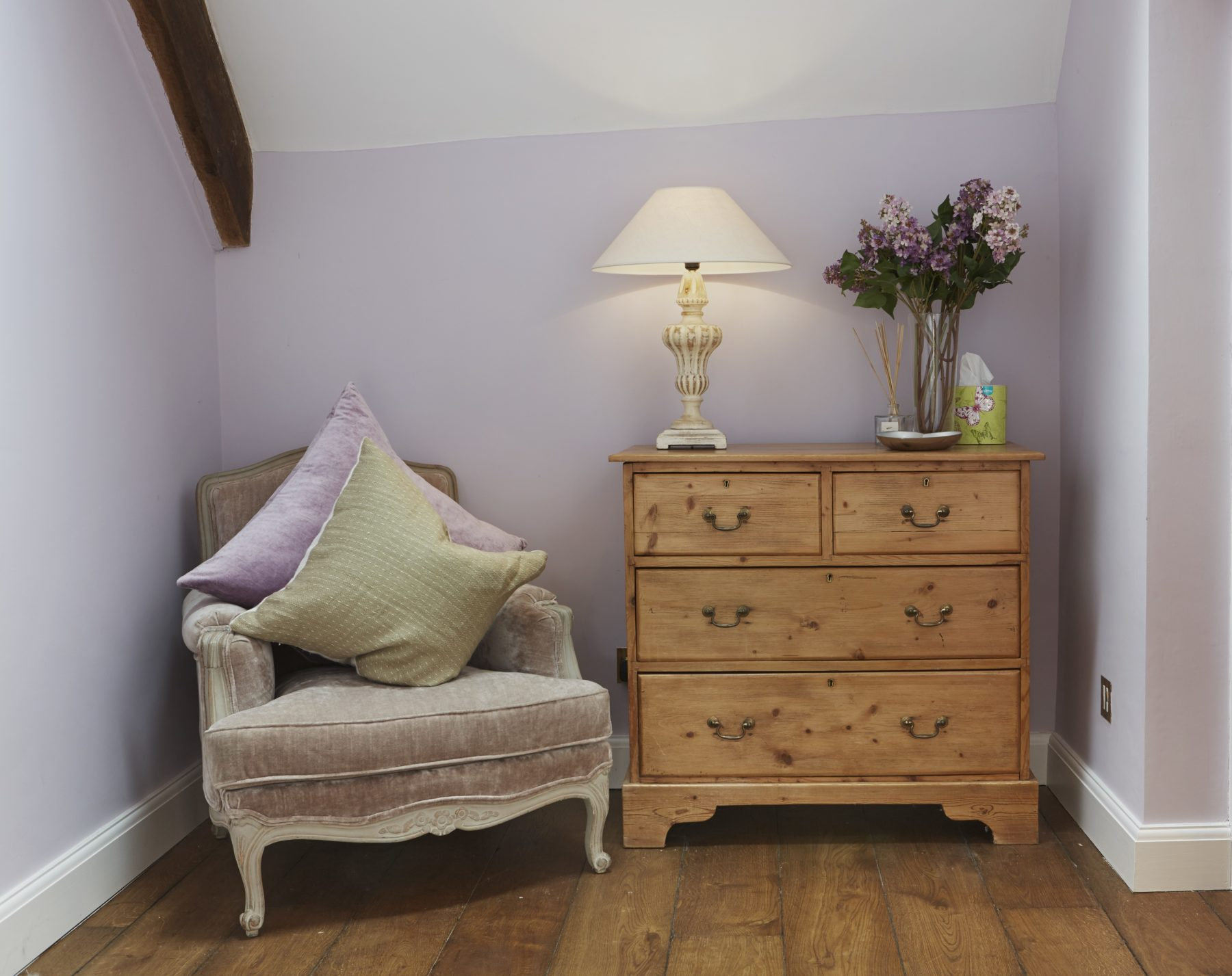 lavender room wood floor wood chest of drawers traditional chair