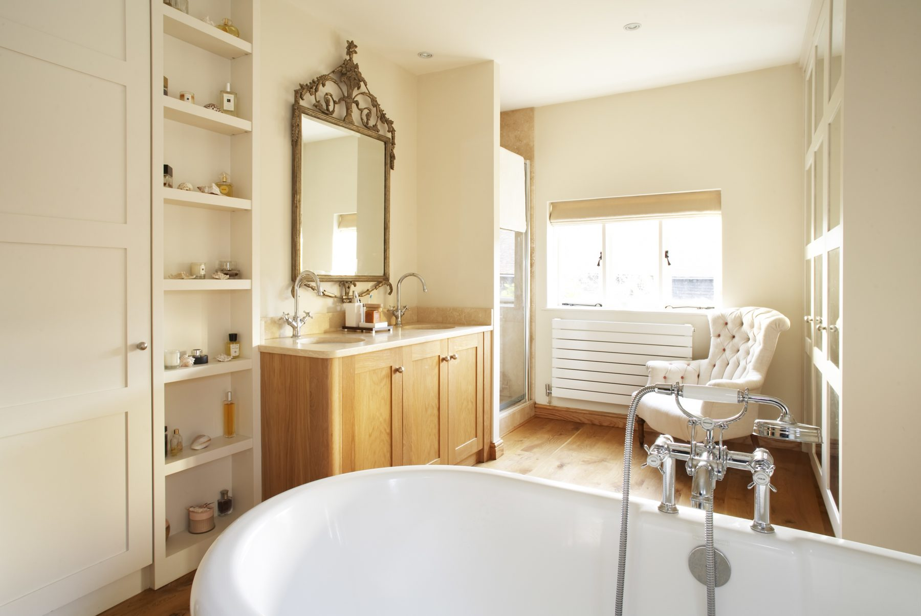 pale yellow bathroom with traditional bath in Wantage